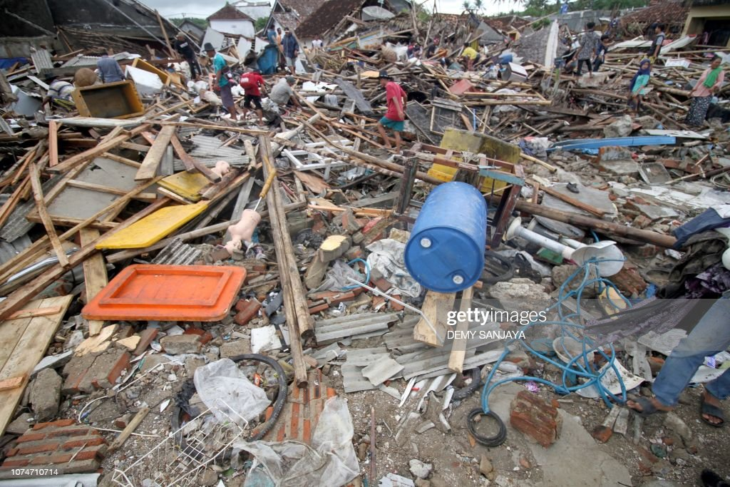 Survivors return to salvage items from destroyed or damaged homes in