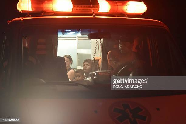 Survivors wait in an ambulance after a dam burst in the village of Bento Rodrigues in Mariana the southeastern Brazilian state of Minas Gerais on...