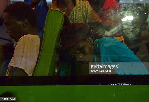 Survivors wait to disembark from a bus as they arrive at the Nyayo stadium in Nairobi on April 4 among survivors of an attack by islamist gunmen...