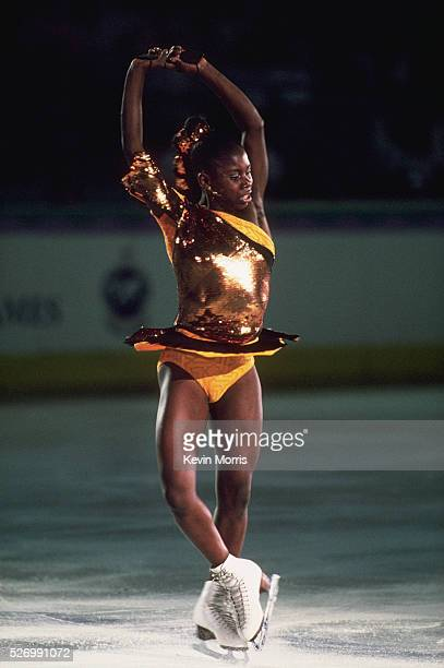 Surya Bonaly of France performs a spin during the women's figure skating competition at the 1990 Goodwill Games Tacoma Dome Tacoma Washington USA