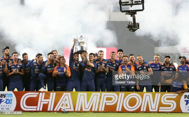 Suryakumar Yadav and Ishan Kishan of India lift the trophy with teammates after winning the 5th T20 International between India and England at...