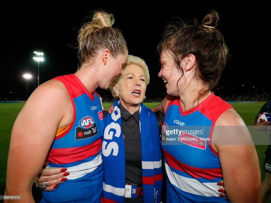 Susan Alberti celebrates with Katie Brennan (left) and Ellie Blackburn of the Bulldogs during the 2017 AFLW Round 01 match between the Western Bulldogs and the Fremantle Dockers at VU Whitten Oval on February 4, 2017 in Melbourne, Australia.