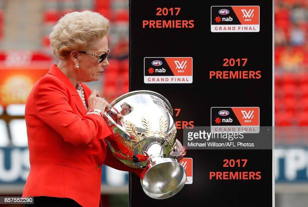 Susan Alberti holds the premiership cup during the 2017 AFLW Grand Final match between the Brisbane Lions and the Adelaide Crows at Metricon Stadium...