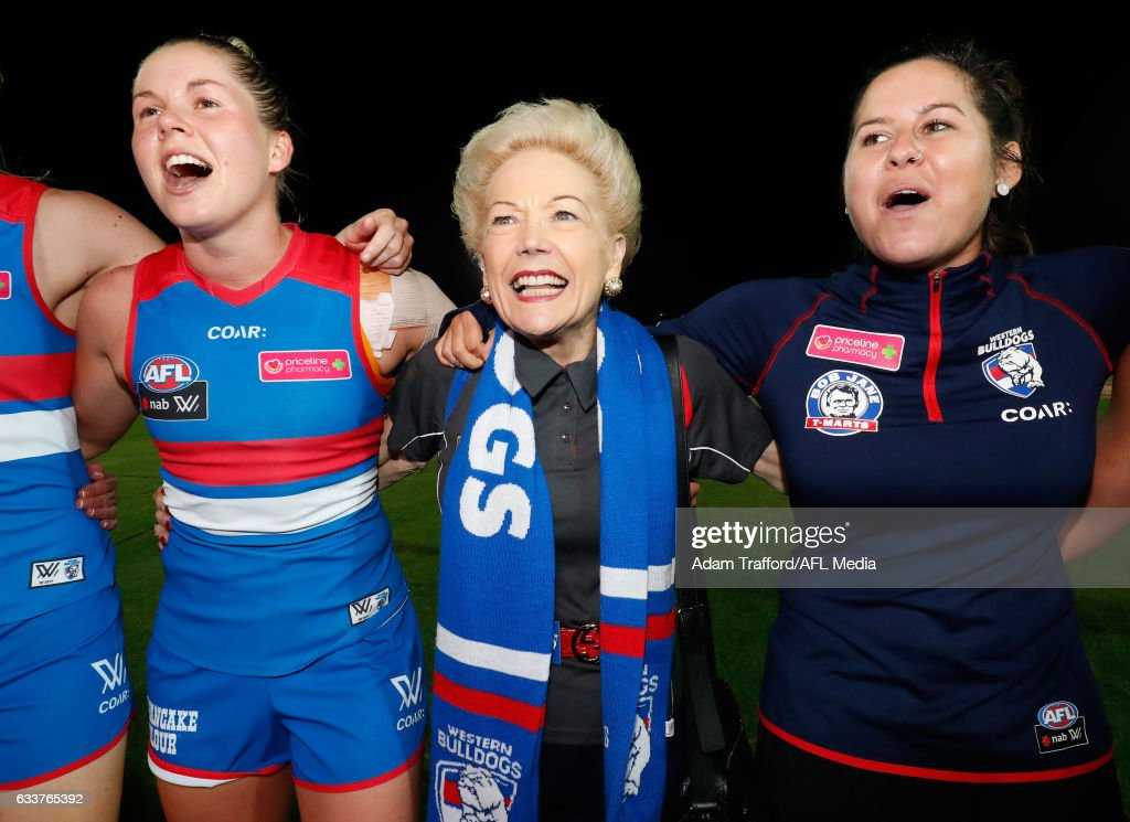 Susan Alberti sings the team song with Bulldogs players Katie Brennan (left) and Romy Timmins during the 2017 AFLW Round 01 match between the Western Bulldogs and the Fremantle Dockers at VU Whitten Oval on February 4, 2017 in Melbourne, Australia.