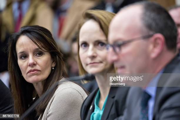 Susan Alt senior vice president of public affairs at Volvo Group North America Inc left listens as Larry Willis president of the transportation...