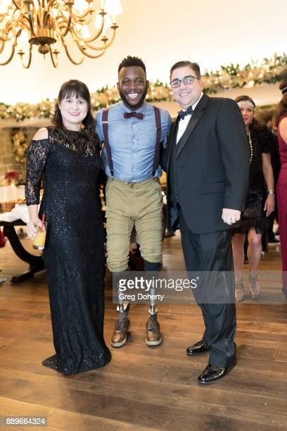 Susan and Jeff Shapiro and Runner Patrick 'Blake' Leeper attend The Thalians Hollywood for Mental Health Holiday Party 2017 at the Bel Air Country...