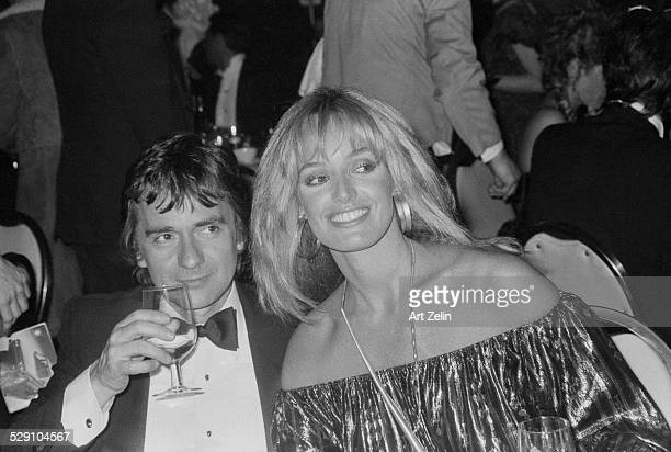 Susan Anton with Dudley Moore at a formal dinner; circa 1960; New York.