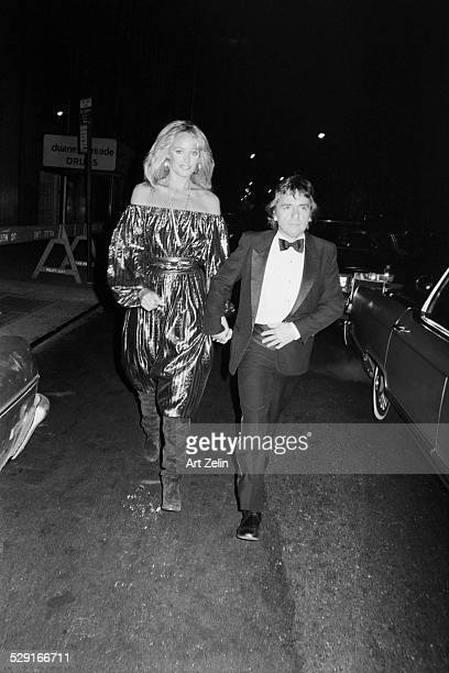 Susan Anton with Dudley Moore in formal dress; circa 1970; New York.