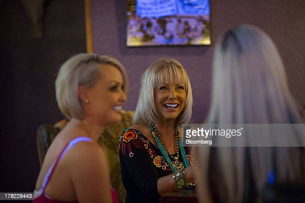 Susan Austin the madam for the Mustang Ranch brothel center talks with sex workers Jaylynn Jones left and Amaris inside the Mustang Ranch brothel in...