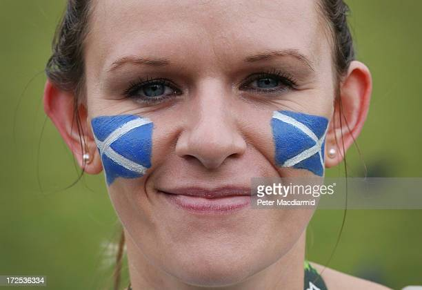 Susan Bissett from Blairgowrie Scotland wears Saltire flag tatoos in support of Andy Murray of Great Britain on day nine of the Wimbledon Lawn Tennis...