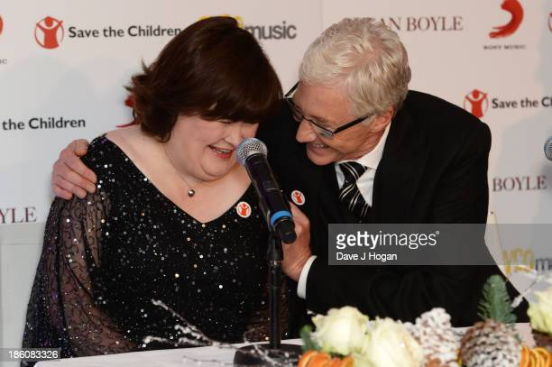 Susan Boyle and Paul O' Grady attend a photocall to announce a charity single for Save The Children at Sony Music on October 28 2013 in London England