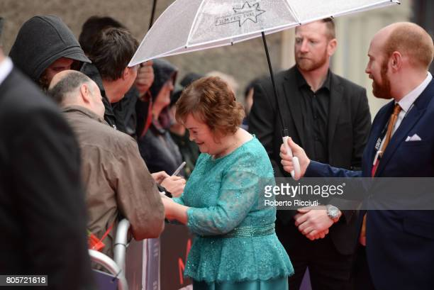 Susan Boyle signs autographs to her fans during the world premiere for 'England is mine' and closing event of the 71st Edinburgh International Film...