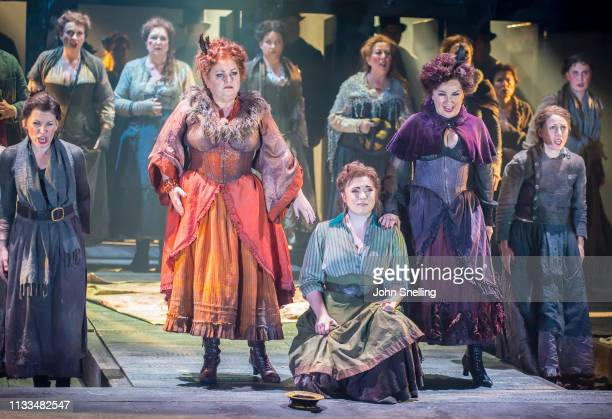 Susan Bullock as Liz Stride Natalya Romaniw as Mary Kelly and Lesley Garrett as Catherine Eddowes with the Company perform on stage in a production...