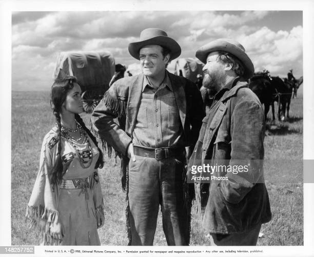 Susan Cabot Van Heflin and Jack Oakie talking out in the prairie in a scene from the film 'Tomahawk' 1951