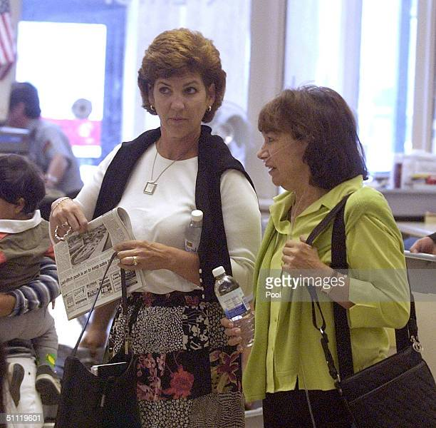 Susan Caudillo Scott Peterson's sister and Jackie Peterson Scott's mother clear check in at the San Mateo County Courthouse July 27 2004 in Redwood...