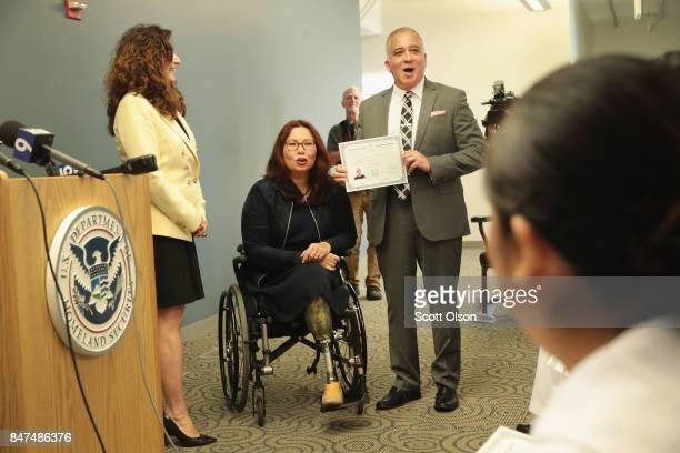 Susan Curda regional director of the US Citizenship and Immigration Services and US Senator Tammy Duckworth present Marine veteran Hector Alfaro who...