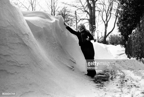 Susan Dibble of St Nicholas is 5ft 5in but dwarfed by drifts in Duffryn Lane Cardiff Wales 22nd February 1978