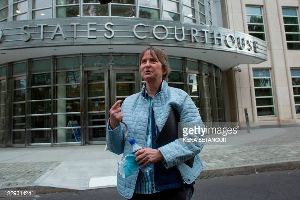 Susan Dones, former NXIVM member later sued by the organization, speaks to reporters as she leaves the Brooklyn federal court after Rainiere was...
