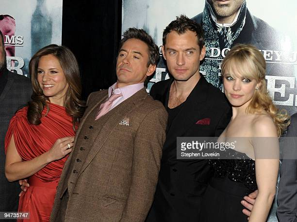"Susan Downey, actor Robert Downey Jr., actor Jude Law and actress Rachel McAdams attend the premiere of ""Sherlock Holmes"" at the Alice Tully Hall,..."