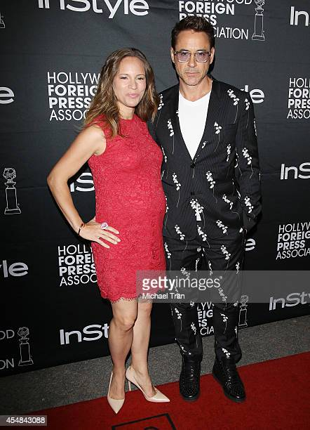 Susan Downey and actor Robert Downey Jr. Arrive at the HFPA & InStyle's 2014 TIFF Celebration held during the 2014 Toronto International Film...