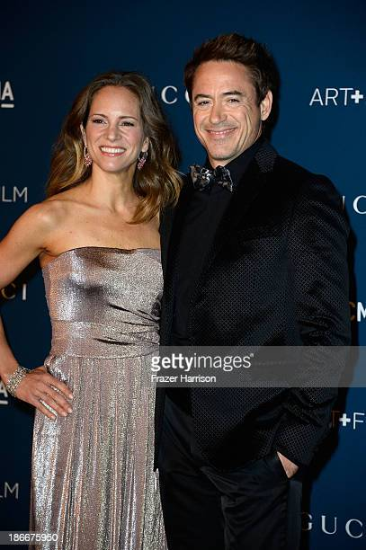 Susan Downey and actor Robert Downey Jr arrive at the LACMA 2013 Art Film Gala on November 2 2013 in Los Angeles California