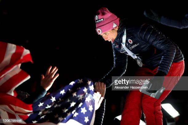 Susan Dunklee of USA celebrates with her team mates at the victory ceremony winning the 2nd place at the Women 7.5 km Sprint Competition at the IBU...
