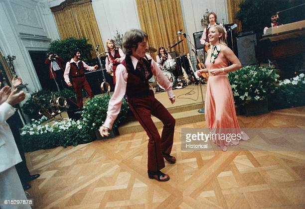 Susan Ford and her escort William Pifer dance during the 1975 Holton Arms School Senior Prom held in the East Room of the White House