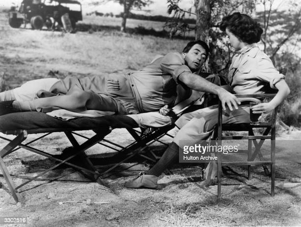 Susan Hayward and Gregory Peck in a scene from Ernest Hemingway's story 'The Snows Of Kilimanjaro' about a wounded hunter in Africa looking back over...