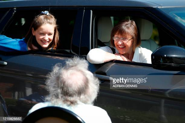 Susan Holding talks with her mother Barbara Webster during a drive-through visit to Gracewell, a residential care home in Adderbury near Banbury,...