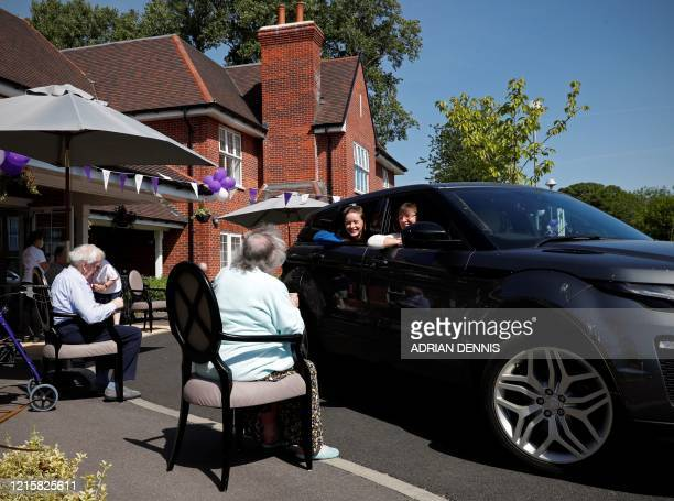 Susan Holding talks with her mother Barbara Webster during a drive-through visit to Gracewell, a residential care home, in Adderbury near Banbury...