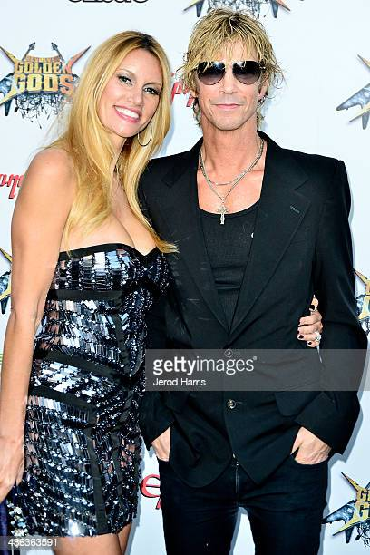 Susan Holmes and Duff Mckagan arrive at the 2014 Revolver Golden Gods Awards at Club Nokia on April 23 2014 in Los Angeles California
