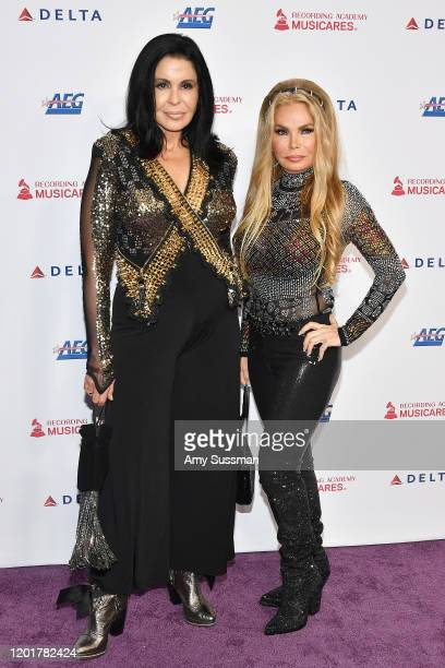 Susan Hughes and Maria Conchita Alonso attend MusiCares Person of the Year honoring Aerosmith at West Hall at Los Angeles Convention Center on...
