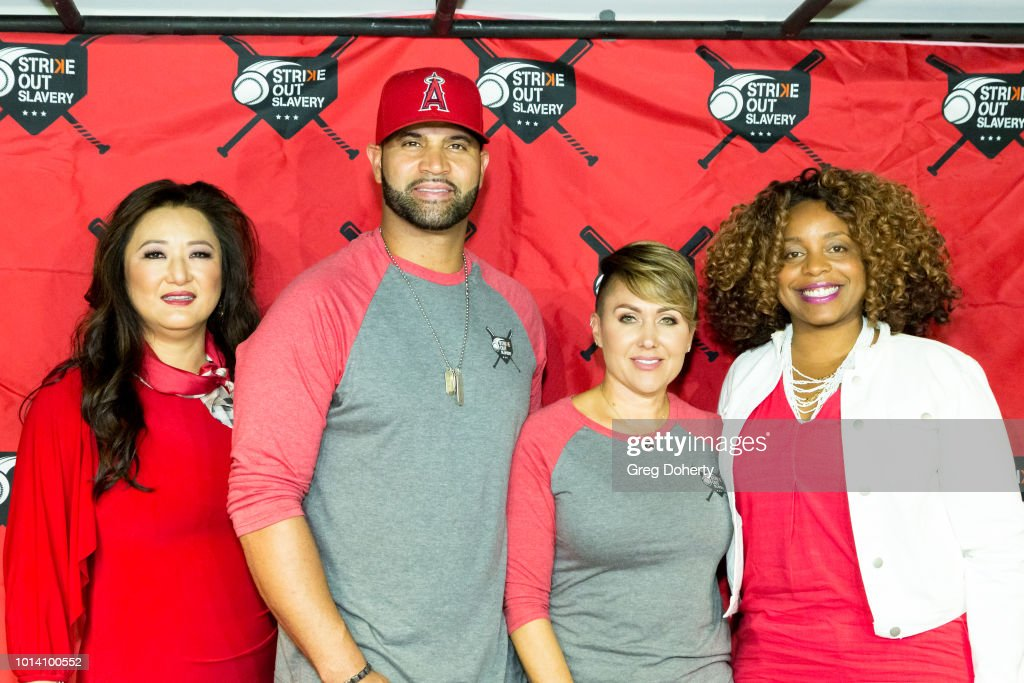 Susan Kang Schroeder, Albert Pujols, Deidre Pujols and Survivor Advocate Stacy Jewell attend the Strike Out Slavery Press Conference at Angel Stadium on August 9, 2018 in Anaheim, California.
