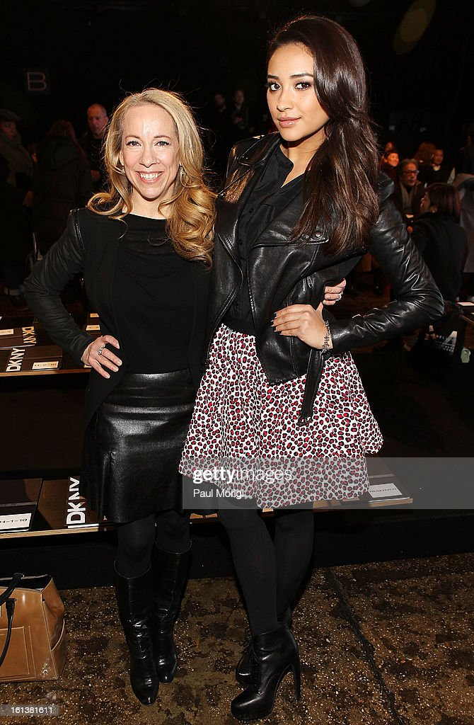 Susan Kaufman (L) and Shay Mitchell pose for a photo at DKNY Women's during Fall 2013 Mercedes-Benz Fashion Week on February 10, 2013 in New York City.