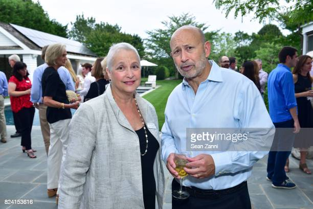 Susan L. Solomon and Lloyd Blankfein attend NYSCF Summer Cocktail Reception at a Private Residence on July 28, 2017 in Sagaponack, New York.