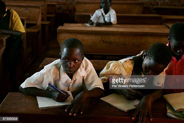 Susan Labol age 10 writes during a match class at St Martine Primary School on May 27 2005 in Laliya Uganda Gladys is a night commuter one of about...
