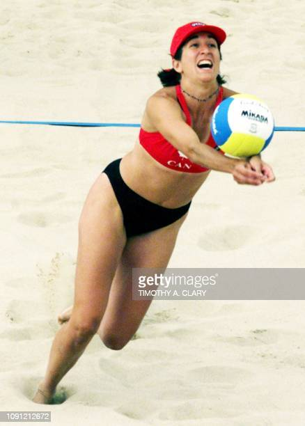 Susan Lesage of Canada lunges for a ball in their match against the United States in the round 2 of the women's beach volleyball competition 31 July...