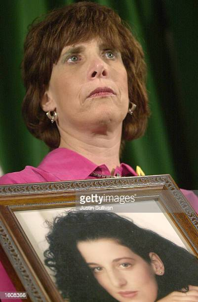 Susan Levy, mother of missing intern Chandra Levy, holds a photo of her daughter during a press conference August 10, 2001 in Modesto, CA. Levy...
