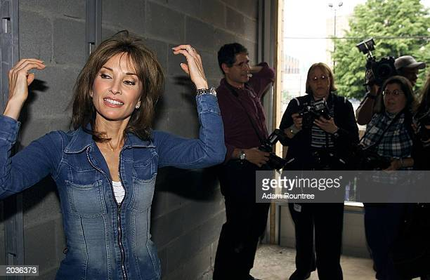 Susan Lucci and cast members from the TV drama All My Children volunteer to build a Habitat for Humanity house May 28 2003 in Bronx neighborhood of...