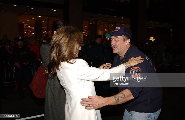 Susan Lucci and fireman during 2002 VH1 Vogue Fashion Awards Arrivals at Radio City Music Hall in New York City New York United States