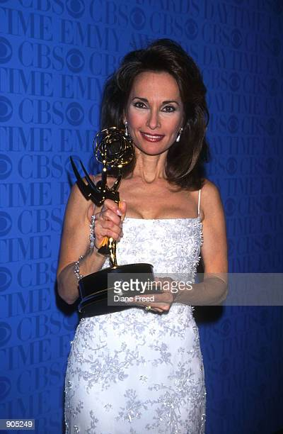 Susan Lucci holds her Emmy award at the annual Daytime Emmy Awards hosted at the Theater at Madison Square Garden in New York City May 21 1999 Lucci...