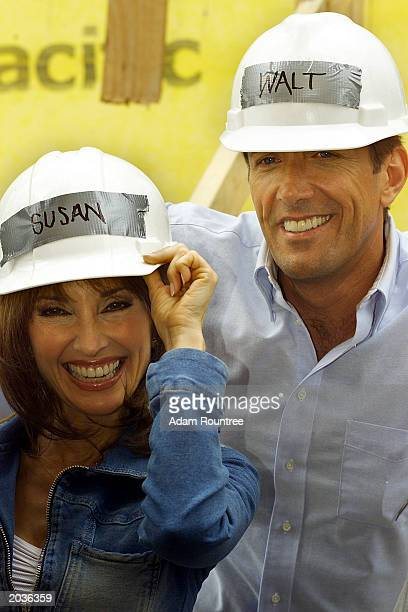 Susan Lucci Walt Willey and cast members from the daytime TV drama All My Children volunteer to build a Habitat for Humanity house May 28 2003 in...