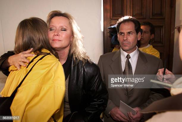 Susan Markowitz mother of slaying victim Nicholas Markowitz is embraced by supporter Thursday after the Death penalty was handed down by Jury verdict...