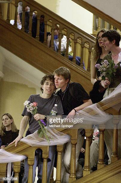 Susan McCray and Yvette Pratt wait on the stairway in City Hall for their turn to apply for a marriage license in the early hours of May 17 2004 in...