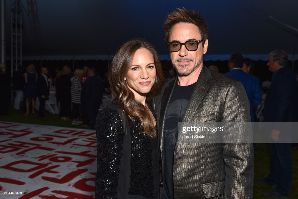 Susan Nicole Downey and Robert Downey Jr. attend The 24th Annual Watermill Center Summer Benefit & Auction at The Watermill Center on July 29, 2017 in Water Mill, New York.