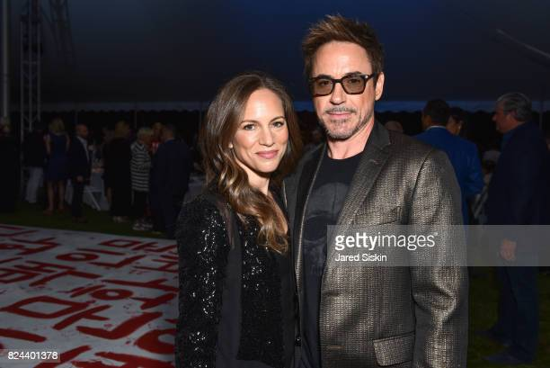 Susan Nicole Downey and Robert Downey Jr attend The 24th Annual Watermill Center Summer Benefit Auction at The Watermill Center on July 29 2017 in...