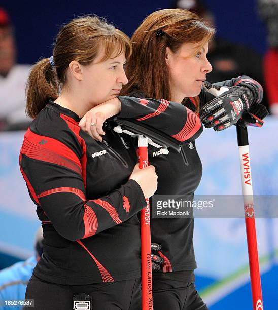 COLUMBIA Susan O'Connor and skip Cheryl Bernard wait during a Sweden timeout in the extra end Canada loses to Sweden in Gold medal match in Women's...
