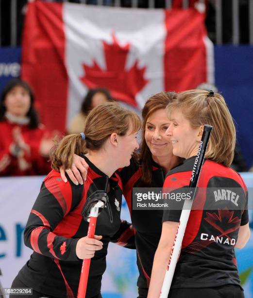 Susan O'Connor skip Cheryl Bernard and Cori Bartel on the ice immediately after Bernard's rock didn't score Canada loses to Sweden in Gold medal...