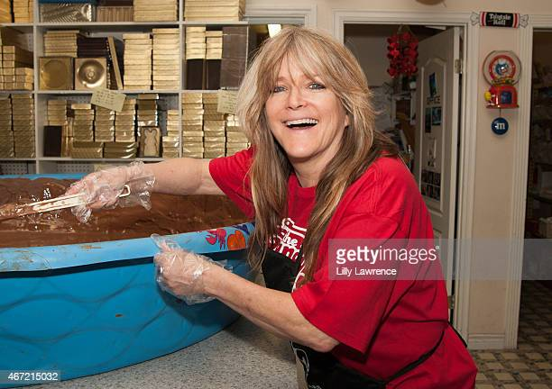 Susan Olsen helps The Candy Factory attempt World Record for The World's Largest Peanut Butter Cup at The Candy Factory on March 21, 2015 in North...