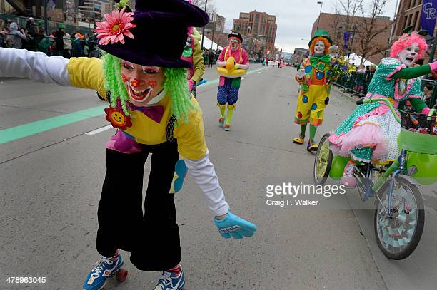 Susan Peace AKA Whirly Bird joins the Colorado Clowns during the St Patrick's Day Parade in Denver CO March 15 2014